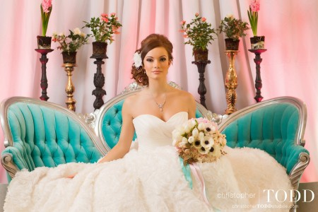 The bride sitting pretty on FormDecor's Victoria Sofa.