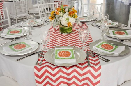 The colorful table setting featured chevron linens from Designer Specialty Linens, floral arrangements by Flowers, Etc. and paper goods by Apersandink Designs.