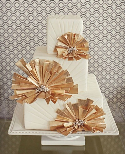 This art deco cake with gold leaf and pearl details is perfect for a 1920s glam wedding.